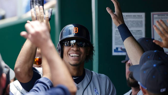 Detroit Tigers' Steven Moya is congratulated in the dugout after hitting a solo home run in the third inning of a baseball game against the Kansas City Royals at Kauffman Stadium in Kansas City, Mo., Sunday, June 19, 2016.