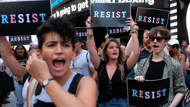 This file photo taken on July 26, 2017 shows protesters shout slogans against President Trump during a demonstration in front of the U.S. Army career center in Times Square, New York. A U.S. federal judge on Dec. 11, 2017, denied a request from the Trump administration to delay allowing transgender recruits to join the military, clearing the way for them to enlist from Jan. 1.