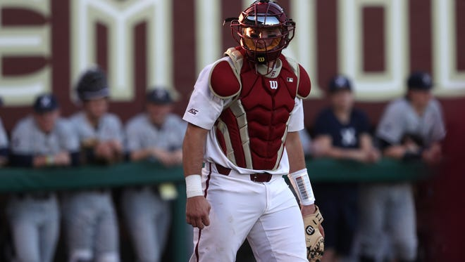 FSU's Cal Raleigh looks for a sign from the dugout against Xavier on opening day at Dick Howser Stadium on Friday, Feb. 16, 2018.