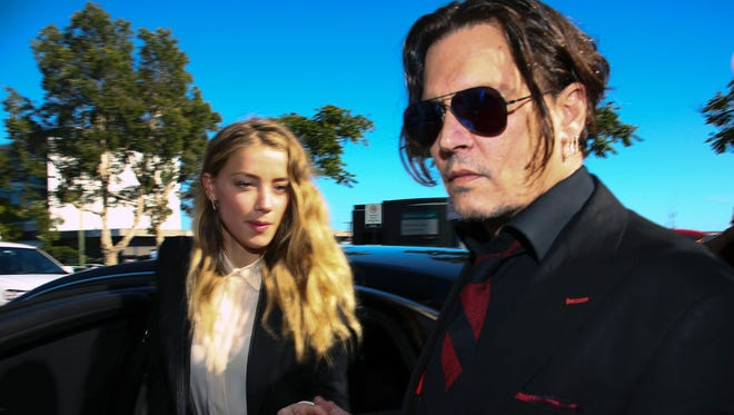 Amber Heard and Johnny Depp on April 17, 2016, in Australia.