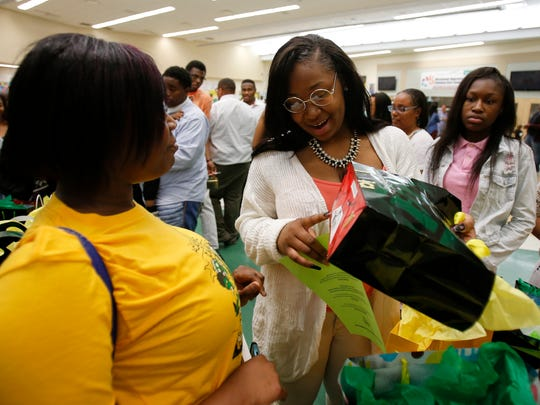 Taft High School English teacher Sinita Scott passes out gifts to the 2016 graduating class from the school, Thursday, May 12, 2016, at Taft High School in the West End. Scott has been a teacher at the high school for the last four years.