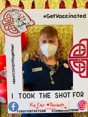 """Cambrian Senior Living employee, Robin Coleman, was one of nearly 100 residents and staff of the Tecumseh assisted living facility, to receive a COVID-19 vaccine last week during the """"#GetVaccinated"""" national campaign. Coleman, and others, marked the occasion by taking a photo, such as the one pictured here."""