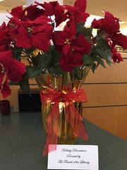 New artificial poinsettias replaced some at the Westland library that were looking a little tattered.