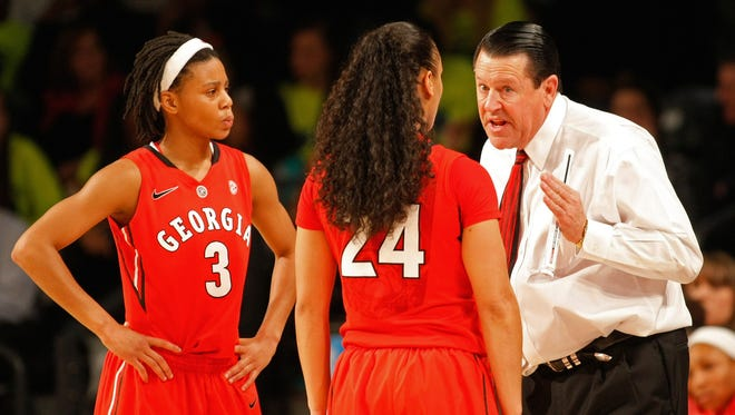 Georgia Bulldogs head coach Andy Landers talks to guard Tiaria Griffin (3) and guard Marjorie Butler (24) against the Georgia Tech Yellow Jackets in the first half at McCamish Pavilion.
