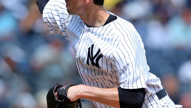 Yankees starting pitcher Brandon McCarthy delivers against the Houston Astros during the first inning of Thursday's game at Yankee Stadium.
