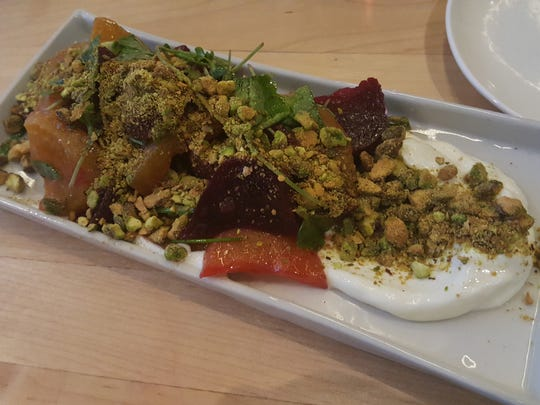 The beet salad with whipped ricotta, watercress and mint from the new menu at Detroit's Standby bar came out drowning in crushed pistachios, begging for a dose of acidity.