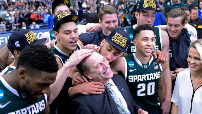 Michigan State coach Tom Izzo and the Spartans celebrate Sunday's victory and a trip to the Final Four.