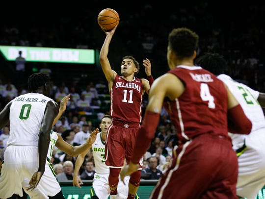 Oklahoma guard Trae Young goes up for a shot during
