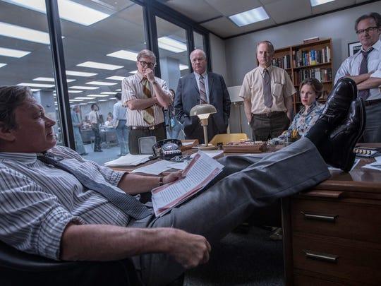 "Tom Hanks (from left), David Cross, John Rue, Bob Odenkirk, Jessie Mueller and Philip Casnoff star in ""The Post."""
