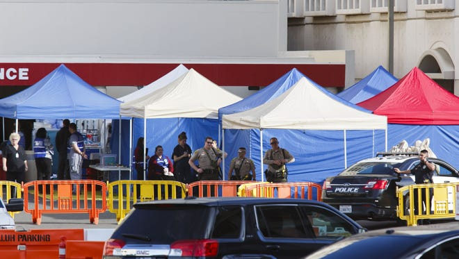Police stand guard outside of the emergency room at the Loma Linda University Medical center during the aftermath of a mass shooting at the Inland Regional Center in San Bernadino on Wednesday.