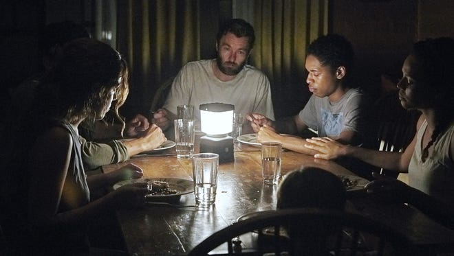 Paul (Joel Edgerton, center) tries to keep everyone calm and collected in the middle of a bad situation in 'It Comes at Night.'