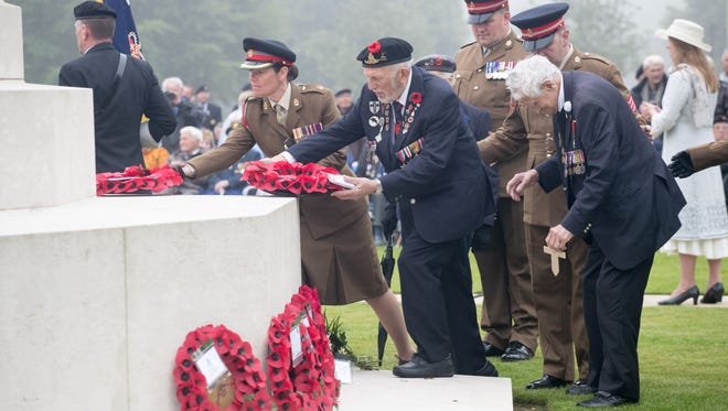 Normandy veterans lay wreaths as they attend an official service of remembrance at Bayeux Cemetery during the D-Day 74th anniversary commemorations in Normandy on June 6, 2018 in Bayeux, France.