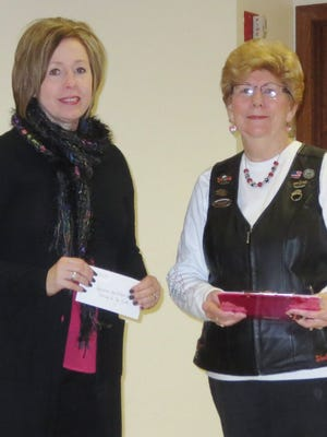 Audrey Sager, right, Ladies of Harley director, presented a $125 donation to Michelle Ries, events coordinator with the Agnesian HealthCare Foundation, to help support the Carol Hyland Caring for You Fund.
