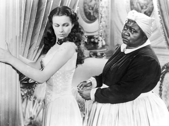 "A promotional photo from ""Gone with the Wind"" depicts Vivien Leigh and Hattie McDaniel."