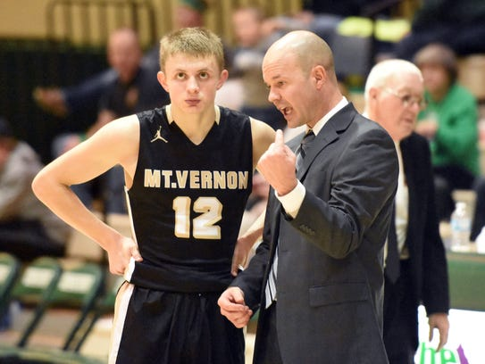 Mt. Vernon guard Michael Ertel (left) and coach Travis