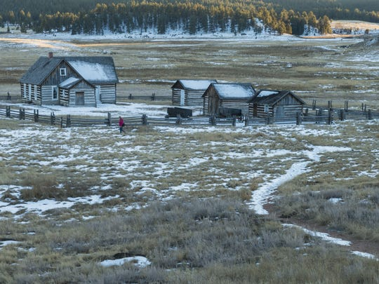 A visitor walks across the homestead of Adeline Hornbeck in the Florissant Valley at Florissant Fossil Beds National Monument. DAWN WILSON/FOR THE COLORADOAN A visitor walks across the homestead of Adeline Hornbeck provides an example of life in the Florissant Valley in the late 1800s.