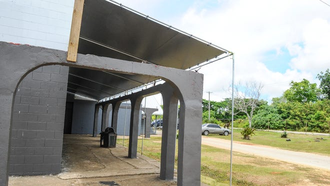 In this 2014 file photo, a temporary canopy can be seen installed over an area where the roof was removed from a sidewalk at Simon Sanchez High School in Yigo.