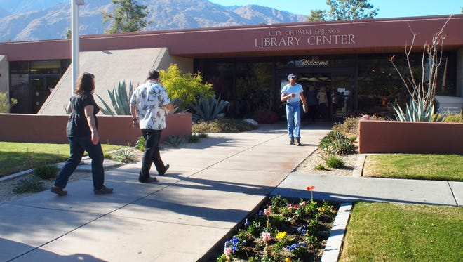 Patrons enter the Palm Springs Library on Sunrise Way.