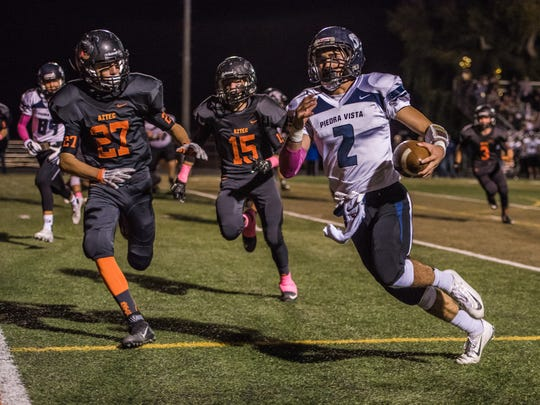 Piedra Vista's Elijah Gamboa outruns Aztec's Sebastian McNeil (27) and Spencer Heyden (15) for a touchdown on Friday at Fred Cook Memorial Stadium in Aztec.