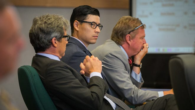 Former Santa Fe County sheriff's deputy Tai Chan, center, on trial for murder in Las Cruces District Court, watches closing arguments made by the prosecution while sitting with his attorneys, John Day, left, and Thomas Clark, June 6, 2016.