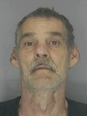 Mark Wilson, 54 of Westland, is charged in the theft of a donation box at a Walmart in Livonia.