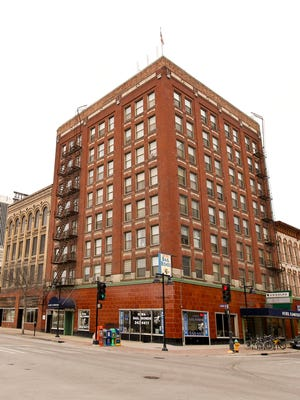 Minneapolis-based developer Sherman Associates plans to turn the former Hotel Randolph and two adjacent buildings at Fourth Street and Court Avenue into 55 market-rate apartments with first-floor retail space.