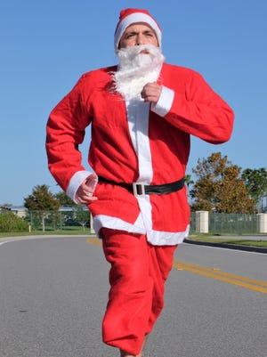 The sprinting Santa, aka Mike Acosta, is the creator of the new Run Run Santa 1-Miler.