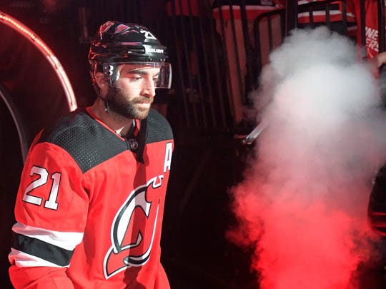 New Jersey Devils right wing Kyle Palmieri (21) comes onto the ice before an NHL hockey game against the Colorado Avalanche Saturday, Oct. 7, 2017, in Newark, N.J. (AP Photo/Bill Kostroun)