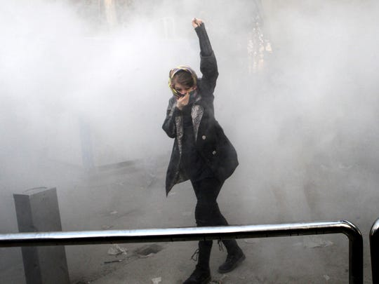 A university student attends a protest inside Tehran