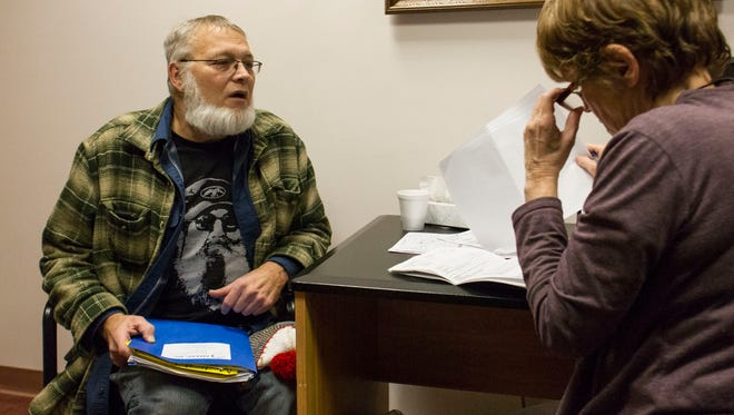 Neal Hoskins, 54, receives legal advice from Linda Kellum at the Burnside Senior Center.
