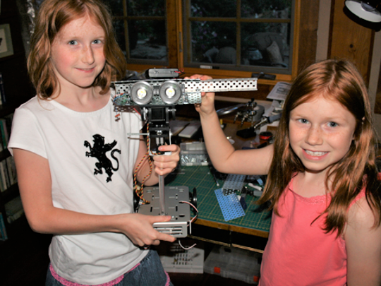 Camille and Genevieve Beatty, of Beatty Robotics, proudly showing off their work-in-progress on the first robot they built, inspired from a Star Wars droid.