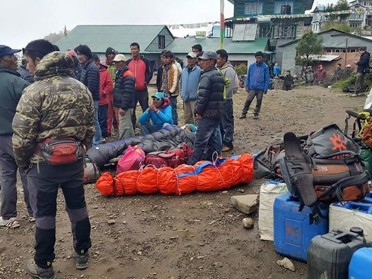 Katherine Atto and her guide made it down the mountain after the quake to the village of Pheriche, where they waited for a plane to Kathmandu. Here, injured people await transport in Pheriche along with the dead.
