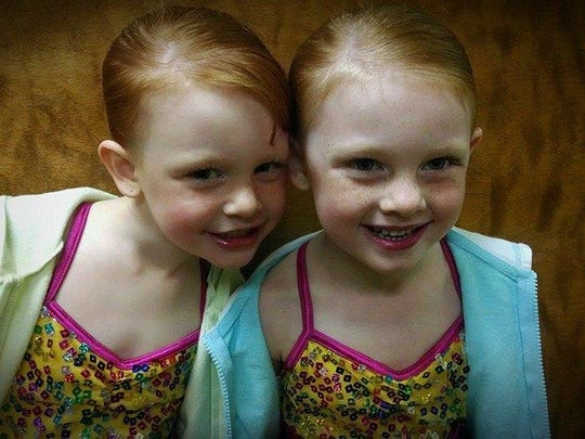 The Greenslade twins — Mimi, left, and Lilly — are 5 years old.