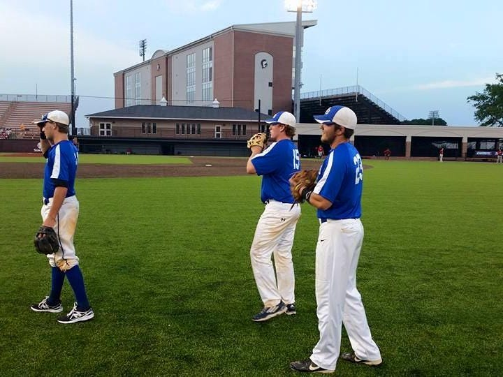 Tallahassee Post 13 American Legion baseball team's Josh Nothdorft (left), Chance Carter (middle) and Richard Ruth warm up on the field at Troy University.
