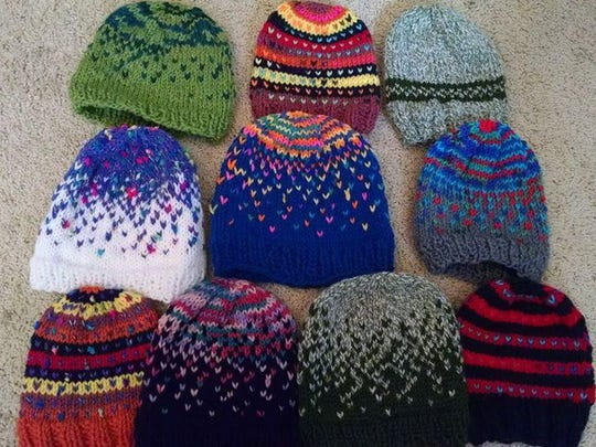 A colorful collection of knit hats will be distributed to those in need by Emily's Hats For Hope Initiative.