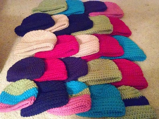 A variety of crocheted and knit winter hats will be distributed to the homeless and working poor.