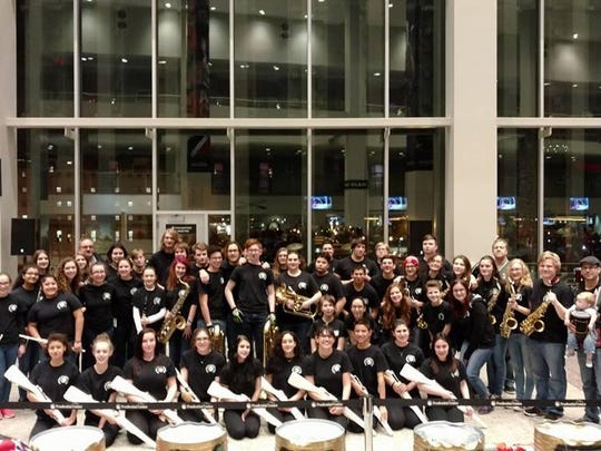 """The Hopatcong High School Marching Chiefs at """"The Rock"""" in Newark during a NJ Devils game."""