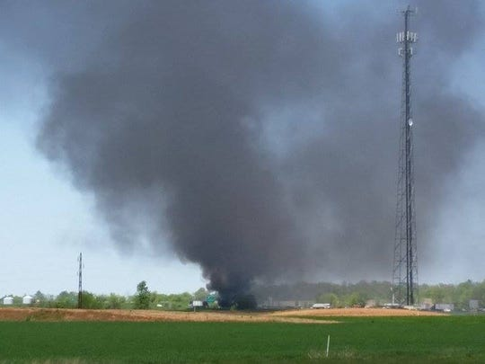 Smoke could be seen from miles away after a semi caught fire on the side of Interstate 24 Thursday.