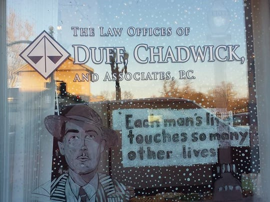 """The law offices of Duff, Chadwick and Associates used the movie """"It's A Wonderful Life"""" as the theme for the window decorating contest. The business was the winner of both the People's Choice and Judge's Choice awards."""