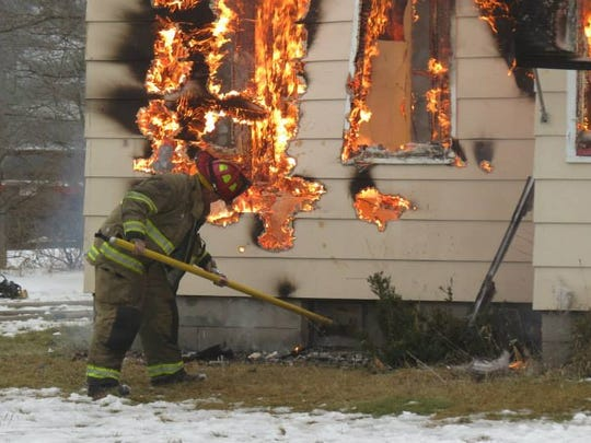 A firefighter works at a training session Dec. 13,