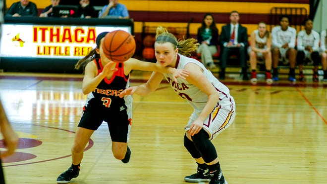 Ithaca junior point guard Sydney Trumble, right, eyes a loose ball as U-E freshman Abigail Madigan pursues. Trumble had 16 points in the Lil Red's 76-74 OT loss.