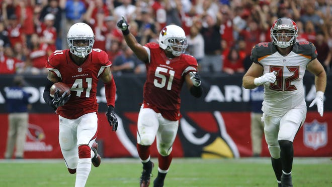 Arizona Cardinals defensive back Marcus Cooper (41) returns an interception for a touchdown on Sunday.