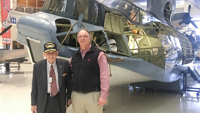 USS Indianapolis survivor Edgar Harrell, left, and friend Eddie Culpepper pose in front of a display at the National Museum of Naval Aviation in Pensacola on Wednesday, December 7, 2016.  Harrell was one of only 317 survivors of the USS Indianapolis that was torpedoed and sunk by the Japanese on July 30, 1945.