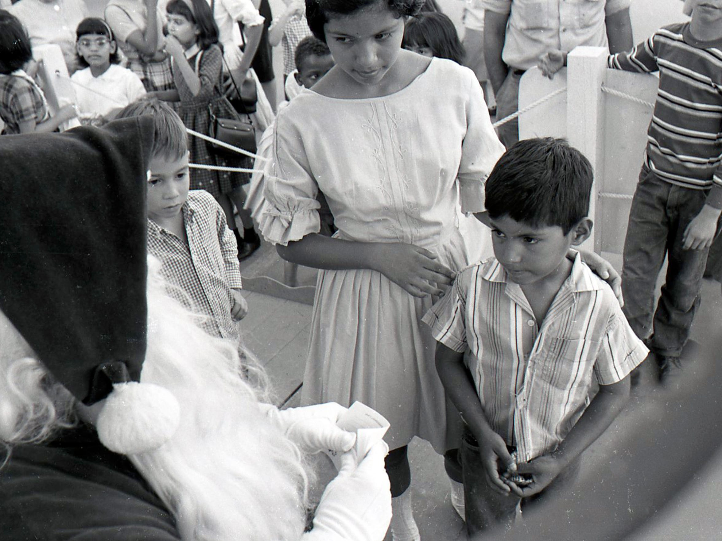 Kids meet with Santa at Peppermint Lane on Chaparral Street in Corpus Christi in 1965.