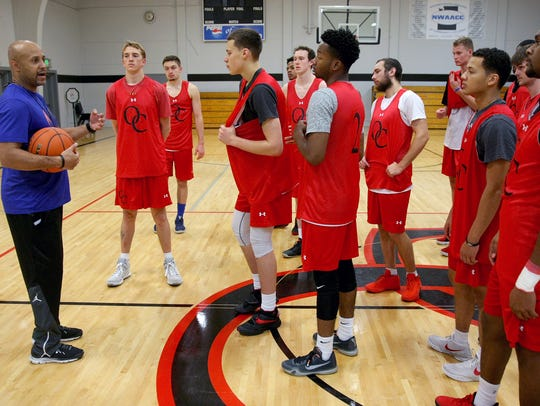 Olympic College men's basketball team head coach Craig Murray address the team before a practice at Bremer Student Center Gym. The Rangers are off to a 2-2 start.