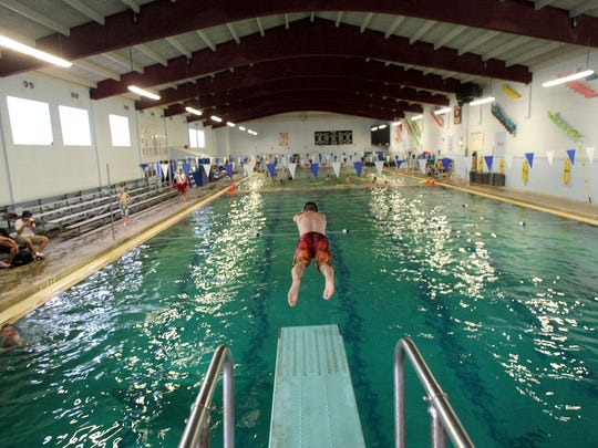 A student dives into the South Kitsap pool in this file photo. Improvements to the pool are among the items that will be funded by a capital levy passed by voters in 2018.