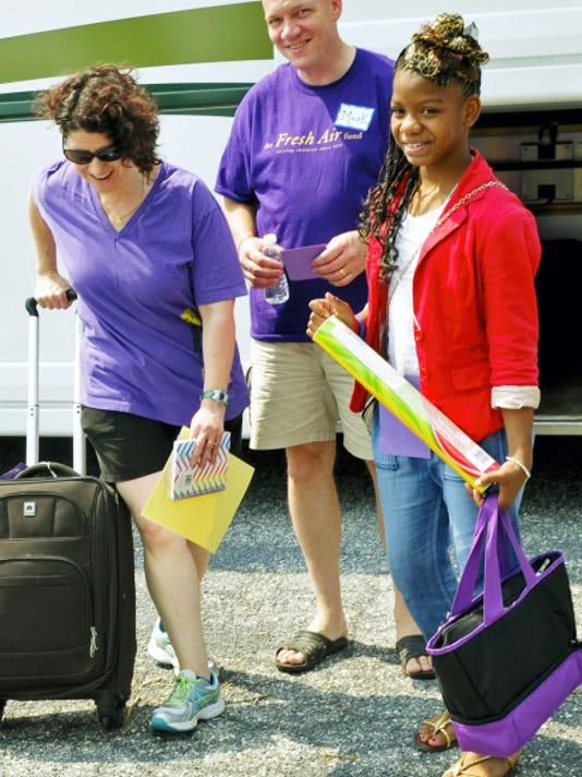 Jordan Williams, 10, right, of Brooklyn,  N.Y., meets meets her host parent Lori Mase on Tuesday, June 30, 2015 at Chambersburg Mall. Mark Simonson, center, Rockville, Md., escorted Jordan from New York.  Fresh Air Fund participants arrived to start a week of sumer vacation in Franklin County. Markell DeLoatch - Public Opinion