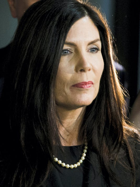 FILE - In this March 11, 2015 file photo, Pennsylvania Attorney General Kathleen Kane walks from the State Supreme Court room at City Hall in Philadelphia.  (AP Photo/Matt Rourke, File)