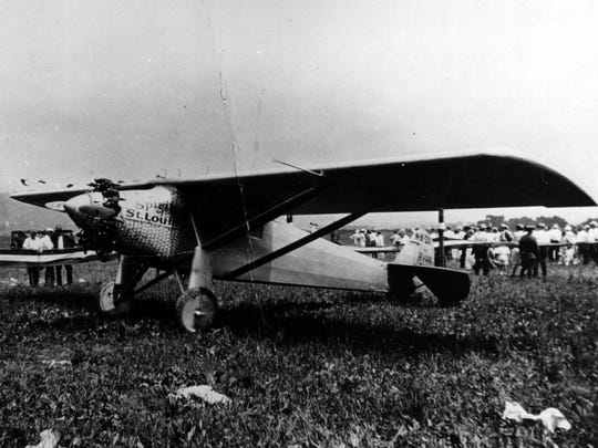 The Spirit of St. Louis was under guard from souvenir seekers when it was parked at Lunken Field in 1927.