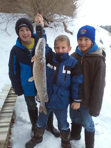 This 28 inch Northern was caught by, left to right,